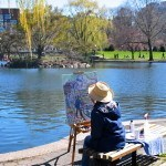 Artist painting in the Public Garden near the swan boats